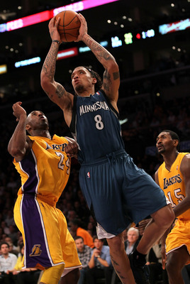 LOS ANGELES, CA - NOVEMBER 09:  Michael Beasley #8 of the Minnesota Timberwolves goes up for a shot over Kobe Bryant #24 of the Los Angeles Lakers at Staples Center on November 9, 2010 in Los Angeles, California. The Lakers won 99-94.   NOTE TO USER: User