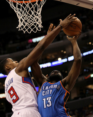 LOS ANGELES - NOVEMBER 3:  DeAndre Jordan #9 of the Los Angeles Clippers blocks a shot by james harden #13 of the Oklahoma City Thunder at Staples Center on November 3, 2010 in Los Angeles, California.  NOTE TO USER: User expressly acknowledges and agrees