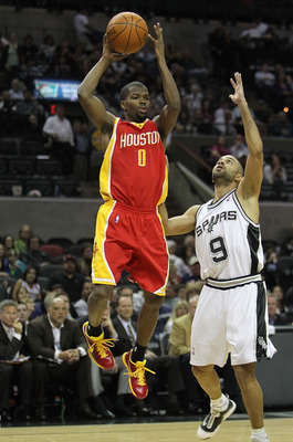 SAN ANTONIO - JANUARY 22:  Guard Aaron Brooks #0 of the Houston Rockets takes a shot against Tony Parker #9 of the San Antonio Spurs at AT&T Center on January 22, 2010 in San Antonio, Texas. NOTE TO USER: User expressly acknowledges and agrees that, by do