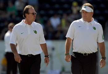 EUGENE, OR - SEPTEMBER 26: (L to R) Defensive coordinator Nick Aliotti and head coach Chip Kelly of the Oregon Ducks speak before the game against the California Bears at Autzen Stadium on September 26, 2009 in Eugene, Oregon. Oregon won the game 42-3.  (