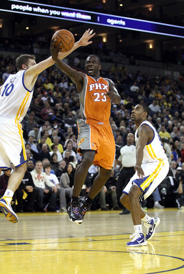 OAKLAND, CA - DECEMBER 02:  Jason Richardson #23 of the Phoenix Suns drives to the basket against the Golden State Warriors at Oracle Arena on December 2, 2010 in Oakland, California. NOTE TO USER: User expressly acknowledges and agrees that, by downloadi