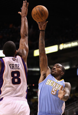 PHOENIX - OCTOBER 22:  J.R. Smith #5 of the Denver Nuggets puts up a shot over Channing Frye #8 of the Phoenix Suns during the preseason NBA game at US Airways Center on October 22, 2010 in Phoenix, Arizona. NOTE TO USER: User expressly acknowledges and a