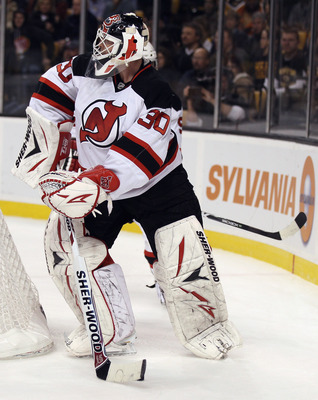 BOSTON - NOVEMBER 15:  Martin Brodeur #30 of the New Jersey Devils clears the puck in the first period against the Boston Bruins on November 15, 2010 at the TD Garden in Boston, Massachusetts.  (Photo by Elsa/Getty Images)