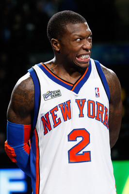 DALLAS - FEBRUARY 13:  Nate Robinson #2 of the New York Knicks reacts during the trophy presentation after his third win during the Sprite Slam Dunk Contest on All-Star Saturday Night, part of 2010 NBA All-Star Weekend at American Airlines Center on Febru