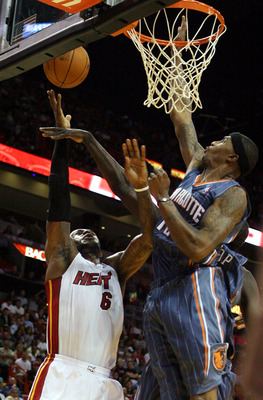 MIAMI - OCTOBER 18:  Forward LeBron James #6 of the Miami Heat is fouled by Forward Tyrus Thomas #12  of the Charlotte Bobcats on October 18, 2010 at the American Airlines Arena in Miami, Florida.  NOTE TO USER: User expressly acknowledges and agrees that