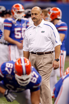 NEW ORLEANS - JANUARY 01:  Offensive coordinator and interim head coach Steve Addazio (C) of the Florida Gators stands on the field before the Allstate Sugar Bowl against the Cincinnati Bearcats at the Louisana Superdome on January 1, 2010 in New Orleans,