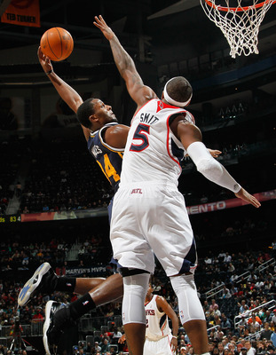 ATLANTA - NOVEMBER 12:  Josh Smith #5 of the Atlanta Hawks leaps to block a dunk by C.J. Miles #34 of the Utah Jazz at Philips Arena on November 12, 2010 in Atlanta, Georgia.  NOTE TO USER: User expressly acknowledges and agrees that, by downloading and/o
