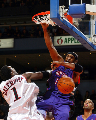 LONDON, CANADA - OCTOBER 17:   Vince Carter #15 of the Toronto Raptors dunks the ball against Samuel Dalembert #1 of the Philadelphia 76ers at the John Labatt Centre on October 17, 2004 in London, Ontario, Canada. Philadephia won the game 108-103.  NOTE T