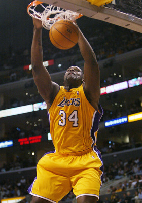 LOS ANGELES - MAY 25:  Shaquille O'Neal #34  of the Los Angeles Lakers dunks in Game 3 of the Western Conference Finals against the Minnesota Timberwolves during the 2004 NBA Playoffs on May 25, 2004 at Staples Center in Los Angeles, California.NOTE TO US