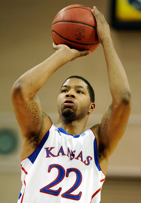LAS VEGAS - NOVEMBER 27:  Marcus Morris #22 of the Kansas Jayhawks shoots a free throw against the Arizona Wildcats during the championship game of the Las Vegas Invitational at The Orleans Arena November 27, 2010 in Las Vegas, Nevada. Kansas won 87-79.