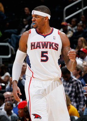 ATLANTA - NOVEMBER 03:  Josh Smith #5 of the Atlanta Hawks reacts after a basket against the Detroit Pistons at Philips Arena on November 3, 2010 in Atlanta, Georgia.  NOTE TO USER: User expressly acknowledges and agrees that, by downloading and/or using