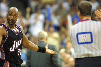1 May 2001:  Karl Malone #32 of the Utah Jazz talks to a referee in game four of round one in the NBA playoffs against the Dallas Mavericks at Reunion Arena in Dallas, Texas.  The Mavericks won 107-77. DIGITAL IMAGE.  Mandatory Credit:  Ronald Martinez/Al