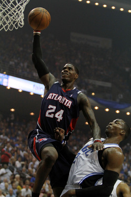 ORLANDO, FL - MAY 06:  Marvin Williams #24 of the Atlanta Hawks scores over Dwight Howard #12 of the Orlando Magic in Game Two of the Eastern Conference Semifinals during the 2010 NBA Playoffs at Amway Arena on May 6, 2010 in Orlando, Florida. NOTE TO USE
