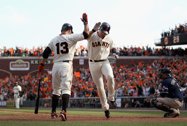 SAN FRANCISCO - OCTOBER 03:  Buster Posey #28 of the San Francisco Giants is congratulated by Cody Ross #13 after he hit a home run in the eighth inning of their game against the San Diego Padres at AT&T Park on October 3, 2010 in San Francisco, Californi