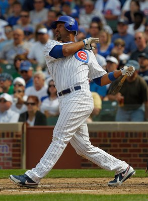 CHICAGO - APRIL 15: Derrek Lee #25 of the Chicago Cubs, wearing a number 42 jersey in honor of Jackie Robinson, takes a swing against the Milwaukee Brewers at Wrigley Field on April 15, 2010 in Chicago, Illinois. The Brewers defeated the Cubs 8-6. (Photo
