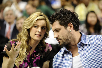 GREENSBORO, NC - MARCH 13:  ESPN reporter Erin Andrews and her 'Dancing With The Stars' partner Maksim Chmerkovskiy watch the Duke Blue Devils play the University of Miami Hurricanes in their semifinal game in the 2010 ACC Men's Basketball Tournament at t