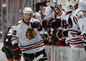 ANAHEIM, CA - NOVEMBER 26:  Patrick Sharp #10 of the Chicago Blackhawks receives high fives from the bench after scoring a goal against the Anaheim Ducks in the third period at the Honda Center on November 26, 2010 in Anaheim, California. The Blackhawks d