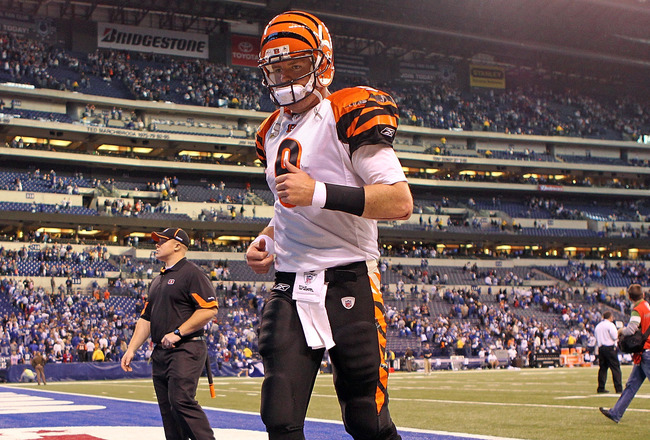 INDIANAPOLIS - NOVEMBER 14: Carson Palmer #9 of the Cincinnati Bengals runs off of the field following the Bengals 23-17 loss to the Indianapolis Colts in the NFL game at Lucas Oil Stadium on November 14, 2010 in Indianapolis, Indiana. The Colts won 23-17