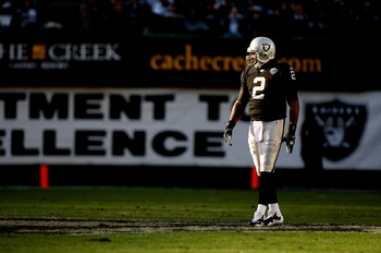 OAKLAND, CA - JANUARY 03:  JaMarcus Russell #2 of the Oakland Raiders looks on against the Baltimore Ravens during an NFL game at Oakland-Alameda County Coliseum on January 3, 2010 in Oakland, California.  (Photo by Jed Jacobsohn/Getty Images)