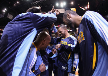 PHOENIX - NOVEMBER 15:  The Denver Nuggets huddle up before the NBA game against the Phoenix Suns at US Airways Center on November 15, 2010 in Phoenix, Arizona. NOTE TO USER: User expressly acknowledges and agrees that, by downloading and or using this ph