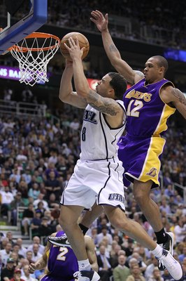 Utah Jazz point guard Deron Williams has always played well in match-ups with the Lakers.  Here he goes by Shannn Brown on a fast break.