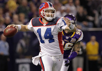 MINNEAPOLIS, MN - DECEMBER 05:  Ryan Fitzpatrick #14 of the Buffalo Bills rolls out against the Minnesota Vikings at the Mall of America Field at the Hubert H. Humphrey Metrodome on December 5, 2010 in Minneapolis, Minnesota.  (Photo by Nick Laham/Getty I
