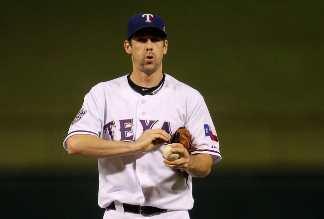 ARLINGTON, TX - NOVEMBER 01:  Cliff Lee #33 of the Texas Rangers pitches gets set to throw a pitch against the San Francisco Giants in Game Five of the 2010 MLB World Series at Rangers Ballpark in Arlington on November 1, 2010 in Arlington, Texas.  (Photo