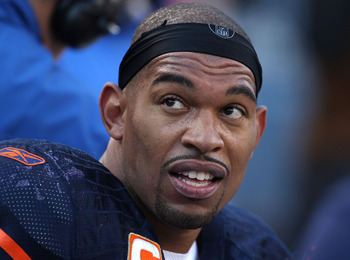 CHICAGO - NOVEMBER 14: Julius Peppers #90 of the Chicago Bears rests on the bench during a game against the Minnesota Vikings at Soldier Field on November 14, 2010 in Chicago, Illinois. The Bears defeated the Vikings 27-13. (Photo by Jonathan Daniel/Getty
