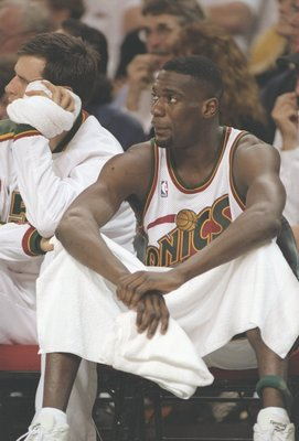 20 May 1996:  Seattle Supersonics forward Shawn Kemp sits on the bench during playoff game against the Utah Jazz at Key Arena in Seattle, Washington.  The Supersonics won the game 91-87. Mandatory Credit: Stephen Dunn  /Allsport