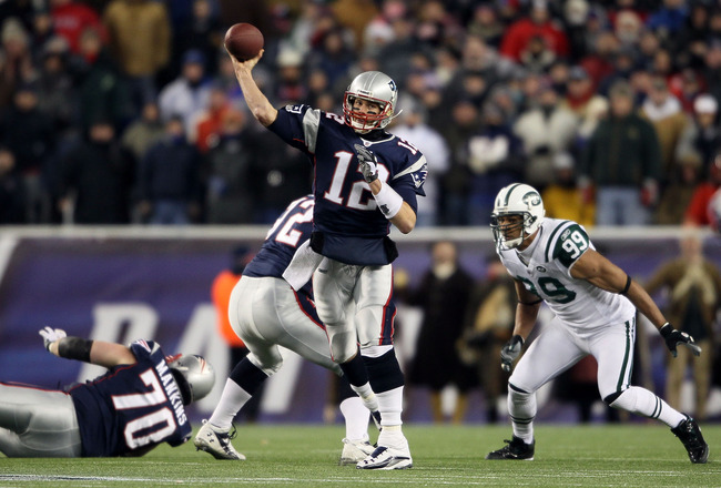 FOXBORO, MA - DECEMBER 06:  Tom Brady #12 of the New England Patriots throws a pass in the first half against the New York Jets at Gillette Stadium on December 6, 2010 in Foxboro, Massachusetts.  (Photo by Elsa/Getty Images)