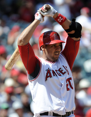 ANAHEIM, CA - SEPTEMBER 12:  Juan Rivera #20 of the Los Angeles Angels of Anaheim react to an inside pitch against the Seattle Mariners during the game at Angel Stadium on September 12, 2010 in Anaheim, California.  (Photo by Harry How/Getty Images)