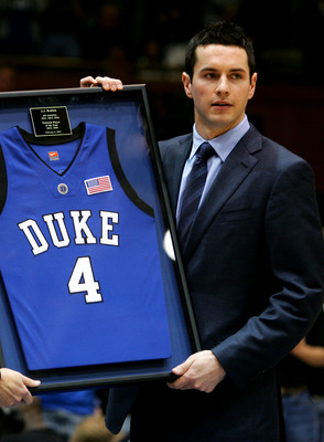 DURHAM, NC - FEBRUARY 04:  Former Duke Blue Devil J.J. Reddick holds his jersey after it was retired during halftime of their game against the Florida State Seminoles at Cameron Indoor Stadium on February 4, 2007 in Durham, North Carolina.  (Photo by Stre