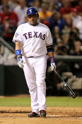 ARLINGTON, TX - NOVEMBER 01:  Bengie Molina #11 of the Texas Rangers reacts after he struck out against the San Francisco Giants in Game Five of the 2010 MLB World Series at Rangers Ballpark in Arlington on November 1, 2010 in Arlington, Texas. The Giants