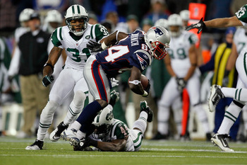 FOXBORO, MA - DECEMBER 06:  Deion Branch #84 of the New England Patriots scores on a 25-yard touchdown reception in the first quarter against James Ihedigbo #44 and Antonio Cromartie #31 of the New York Jets at Gillette Stadium on December 6, 2010 in Foxb