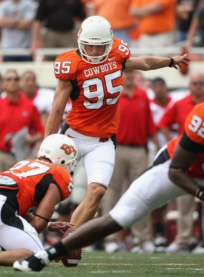 STILLWATER, OK - SEPTEMBER 05:  Kicker Dan Bailey #95 of the Oklahoma State Cowboys kicks a field goal during the college football game against the Georgia Bulldogs at Boone Pickens Stadium on September 5, 2009 in Stillwater, Oklahoma.  The Cowboys defeat