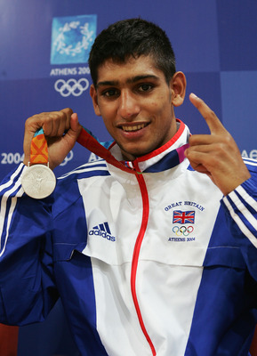 ATHENS - AUGUST 29:  Amir Khan of Great Britain poses with his bronze medal for the men's boxing 60 kg event on August 29, 2004 during the Athens 2004 Summer Olympic Games at Peristeri Olympic Boxing Hall in Athens, Greece. (Photo by Getty Images)
