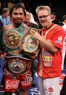 LAS VEGAS - NOVEMBER 14:  Manny Pacquiao celebrates his 12 round TKO victory against Miguel Cotto with trainer Freddy Roach during their WBO welterweight title fight at the MGM Grand Garden Arena on November 14, 2009 in Las Vegas, Nevada.  (Photo by Al Be