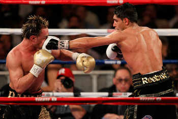 NEW YORK - MAY 15:  Amir Khan (R) of Great Britain and Paulie Malignaggi exchange blows during the WBA light welterweight title fight at Madison Square Garden on May 15, 2010 in New York City.  (Photo by Chris Trotman/Getty Images)