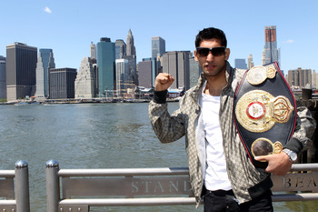 NEW YORK - MAY 10:  British boxer Amir Khan poses with the WBA World light welterweight championship belt by the Brooklyn Bridge on May 10, 2010 in the Brooklyn borough of New York City.  (Photo by John Gichigi/Getty Images)