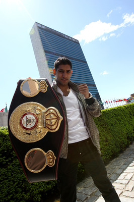 NEW YORK - MAY 10:  British boxer Amir Khan poses with the WBA World light welterweight championship belt in front of the United Nations headquarters on May 10, 2010 in New York City.  (Photo by John Gichigi/Getty Images)
