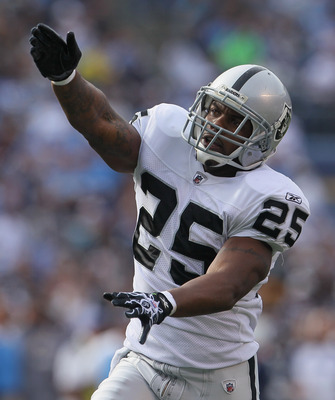 SAN DIEGO - DECEMBER 05:  Rock Cartwright #25 of the Oakland Raiders celebrates after his team recovered a fumble in the first quarter against the San Diego Chargers at Qualcomm Stadium on December 5, 2010 in San Diego, California. The Raiders defeated th