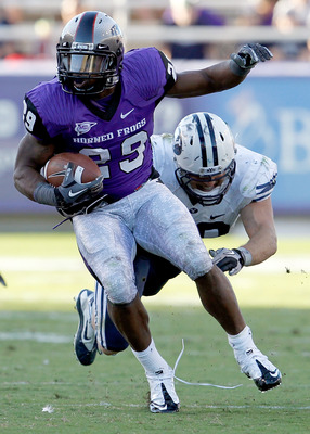 FORT WORTH, TX - OCTOBER 16:  Tailback Matthew Tucker #29 of the TCU Horned Frogs carries the ball against linebacker Jadon Wagner #49 of the BYU Cougars at Amon G. Carter Stadium on October 16, 2010 in Fort Worth, Texas.  TCU beat BYU 31-3.  (Photo by To