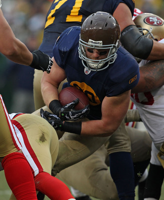 GREEN BAY, WI - DECEMBER 05: John Kuhn #30 of the Green Bay Packers runs against the San Francisco 49ers at Lambeau Field on December 5, 2010 in Green Bay, Wisconsin. The Packers defeated the 49ers 34-16. (Photo by Jonathan Daniel/Getty Images)