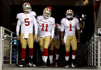 GLENDALE, AZ - NOVEMBER 29:  Quarterbacks David Carr #5, Alex Smith #11 and Troy Smith #1 of the San Francisco 49ers walk out onto the field before the NFL game against the Arizona Cardinals at the University of Phoenix Stadium on November 29, 2010 in Gle