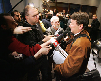 NEW YORK - MARCH 1:  Mike Milbury (R), General Manager of the New York Islanders, addresses the media following the National Hockey League Board of Governors meeting March 1, 2005 at the Westin Hotel at Times Square in New York City.  (Photo by Bruce Benn