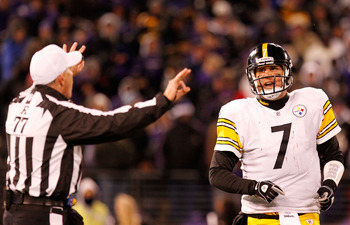 BALTIMORE, MD - DECEMBER 05:  Quarterback Ben Rothlisberger #7 of the Pittsburgh Steelers argues with referee Terry McAulay #77 during the game against the Baltimore Ravens at M&T Bank Stadium on December 5, 2010 in Baltimore, Maryland. Pittsburgh won 13-