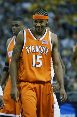 NEW ORLEANS - APRIL 5:  Carmelo Anthony #15 of the Syracuse University Orangeman smiles during the semifinal round of the NCAA Final Four Tournament against the University of Texas at Austin Longhorns at the Louisiana Superdome on April 5, 2003 in New Orl