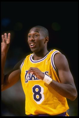 16 Oct 1996:  Guard Kobe Bryant of the Los Angeles Lakers celebrates during a game against the Dallas Mavericks at Selland Arena in Fresno, California.  The Lakers won the game, 90-80. Mandatory Credit: Todd Warshaw  /Allsport
