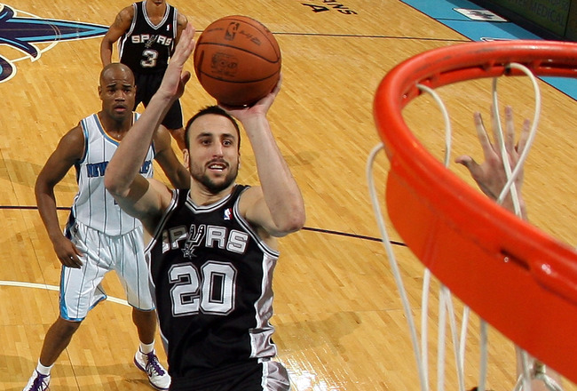 NEW ORLEANS - NOVEMBER 28:  Manu Ginobili #20 of the San Antonio Spurs shoots the ball over Jason Smith #14 of the New Orleans Hornets at the New Orleans Arena on November 28, 2010 in New Orleans, Louisiana.  The Spurs defeated the Hornets 109-95.  NOTE T