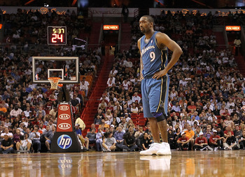MIAMI, FL - NOVEMBER 29:  Gilbert Arenas #9 of the Washington Wizards looks on during a game against the Miami Heat at American Airlines Arena on November 29, 2010 in Miami, Florida. NOTE TO USER: User expressly acknowledges and agrees that, by downloadin